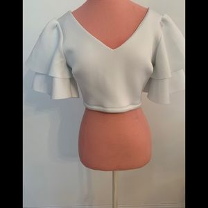 Brand new white crop top with ruffle sleeves